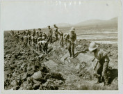 OFFICIAL PHOTOGRAPH TAKEN ON THE SALONIKA FRONT. LABOURS BATTALIONS AT WORK ON THE GREAT DAUBATALI MARSCHES DRAINING THE LAND TO PREVENT MALARIA.